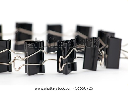 Binder clips are held together in a circle