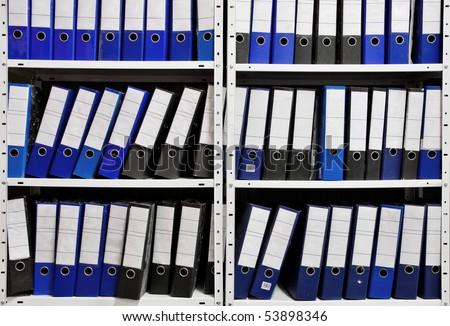 binder folders in shelf - stock photo