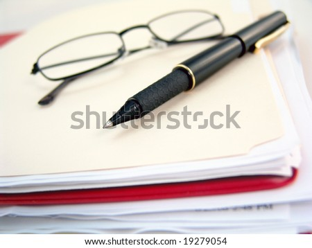 binder, glasses and pen