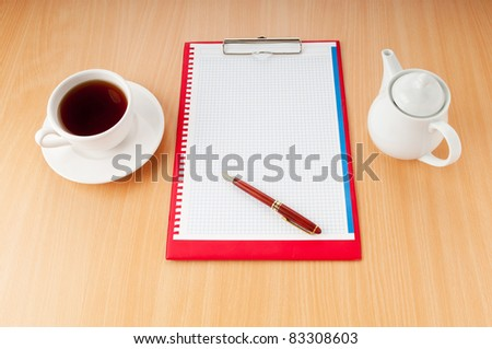 Binder with blank page and tea