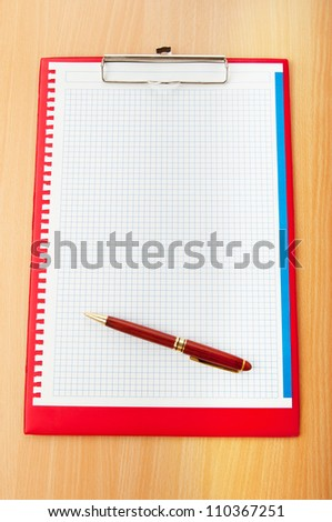 Binder with blank page with pen - stock photo