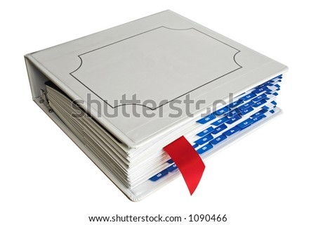 Binder with red bookmark and blue tabs