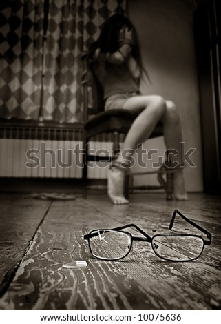 Bindfloded girl for chair in old room - stock photo