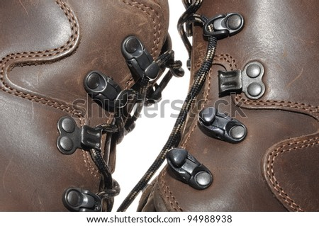 Binding of leather shoes on mountain expeditions - stock photo