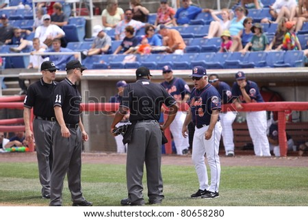 BINGHAMTON, NY - JULY 7: Binghamton Mets manager, former MLB player, Wally Backman argues a call  during a game against the Portland Sea Dogs at NYSEG Stadium on July 7, 2011 in Binghamton, NY - stock photo