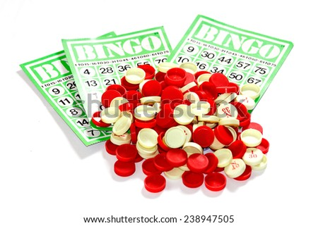Bingo balls and cards, vertical, cross processed - stock photo