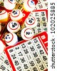 Bingo balls & cards, vertical, cross processed - stock photo
