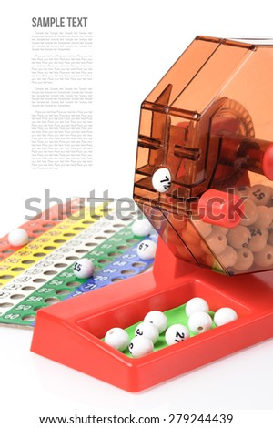 Bingo balls in plastic cage isolated on white background - stock photo