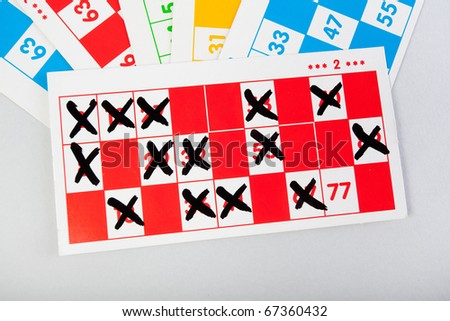 Bingo numbered cards with numbers signed - stock photo