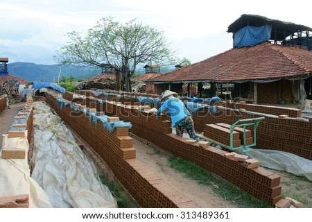 BINH DINH, VIET NAM- AUG22: Old brickwork at countryside Vietnamese, trade village to product brick, material for construction, make from soil, burn by firewood, ecology problem, Vietnam, Aug 22, 2015