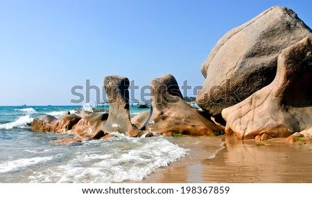 BINH THUAN, VIETNAM, April 28, 2014 Co Thach beach in sunrise, Binh Thuan, Vietnam. Co Thach is famous for the Hang temple, wild nature and the seven-color stone bank. - stock photo