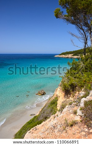 Binigaus beach seen from cliff viewpoint on beautiful coast of Menorca, Balearic Islands