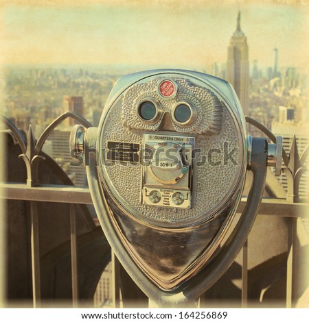 Binocular in New York City.Image in grunge and retro style. - stock photo