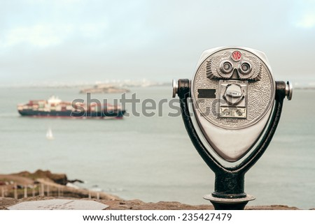 Binocular next to the waterside promenade in San Francisco looking out to the Bay. - stock photo