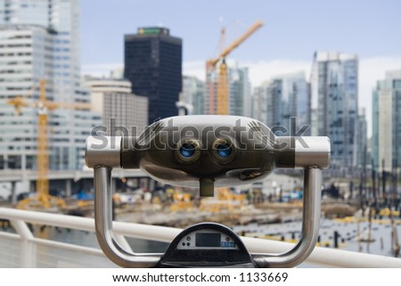 Binocular with an out of focus construction site in the background - stock photo