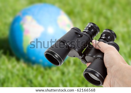 Binoculars and Globe, concept of environmental conservation