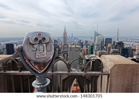 Binoculars looking down to the Empire State building in New York City. New York, USA. - stock photo
