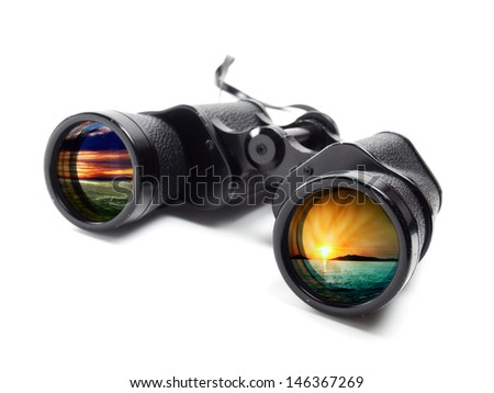 Binoculars on a white background with different seascape on each lens.