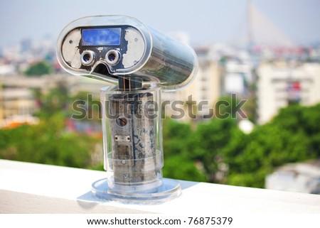 Binoculars overlooking a skyline in Bangkok ,Thailand - stock photo