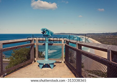 Binoculars overlooking the Gold Coast beaches and the ocean, on a cliff near byron bay lighthouse.