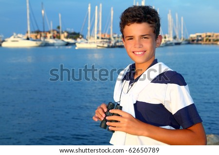 binoculars teenager boy on boat marina in blue summer vacation - stock photo