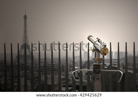 Binoculars telescope and Paris view and Eifel tower in the evening - stock photo