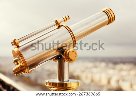 binoculars telescope and view on Paris - stock photo