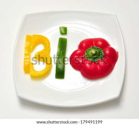 bio food vegetable slice text on white plate - stock photo