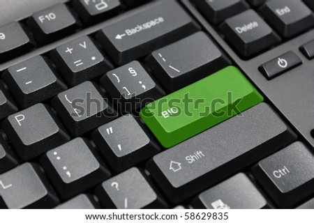 BIO green key on black computer keyboard.
