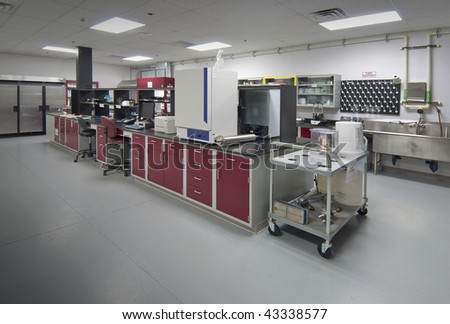 Bio lab in gray with burgundy cabinets - stock photo