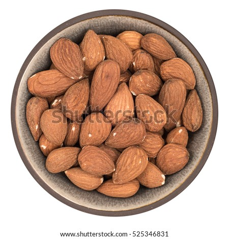 Bio organic almonds in ceramic bowl isolated on white background, top view