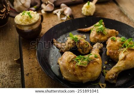 Bio roast chicken with herbs and garlic, couscous, organic garlic from garden - stock photo