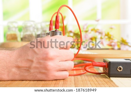 Biofeedback device used in alternative medicine electrotherapy. - stock photo