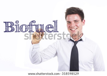 Biofuel - Young smiling businessman writing on transparent surface - stock photo