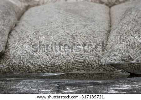 Biofuels for all types of boilers and furnaces. The polyethylene bags. - stock photo
