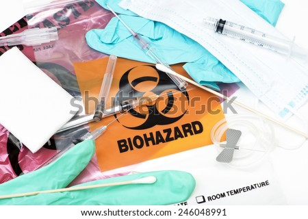 Biohazard waste bags with used syringes,  needles, bandages, and other medical waste. - stock photo