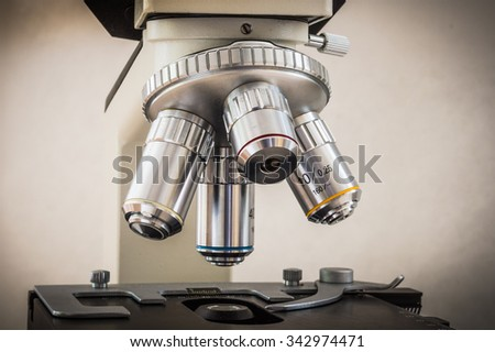 Biological microscope in scientific and healthcare research laboratory