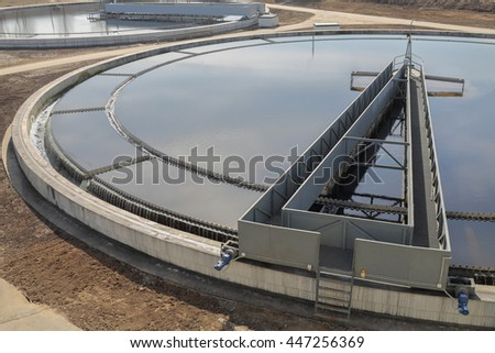 Biological wastewater treatment is carried out in aeration tanks of propellant. Along rails in circle rotates sludge scraper - it separates sludge, primary settler - stock photo