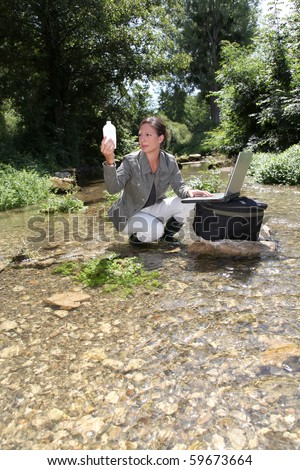 Biologist testing quality of water - stock photo
