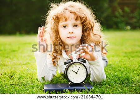 Biology lesson in nature. Schoolgirl held up a hand to answer a question. Educational and medical concepts. - stock photo