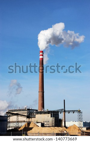Biomass combustion plant with wood and biomass - stock photo