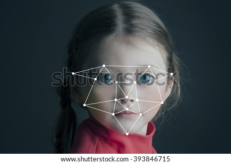 Biometric verification - small girl face recognition. Toned - stock photo