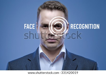 Biometric verification - young man face recognition - stock photo