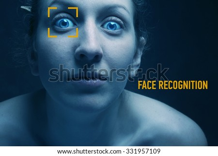 Biometric verification - young woman face recognition - stock photo