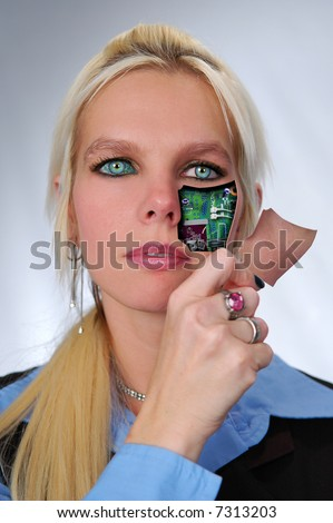 Bionic woman removing cover from face.