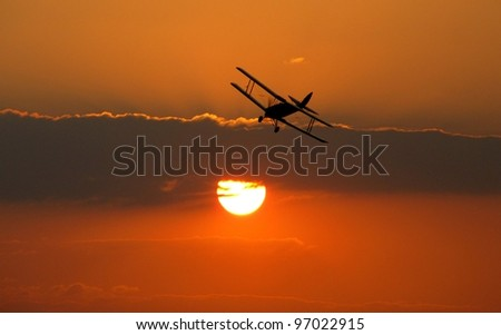Biplane coming in to land - stock photo