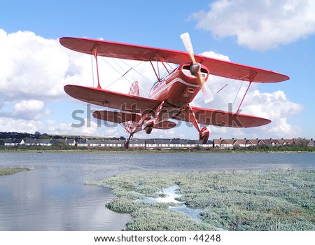 Biplane doing stunts. Best for web use or smaller scale. - stock photo