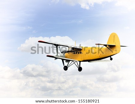 Biplane in the sky - stock photo