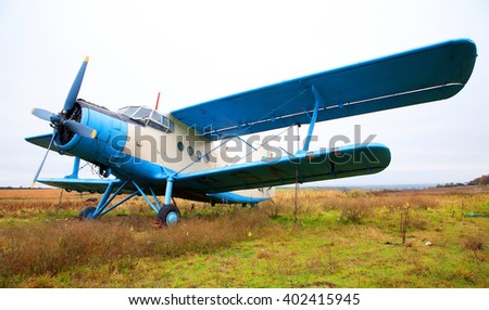 Biplane on the ground - stock photo