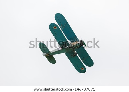 biplane Polikarpov Po-2 on the background of the cloudy sky, the aircraft  WW2 - stock photo